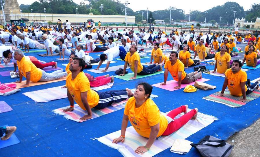 Mysuru: People participate in a Yoga programme at Mysuru Palace on Oct 2, 2016. (Photo: IANS) by .