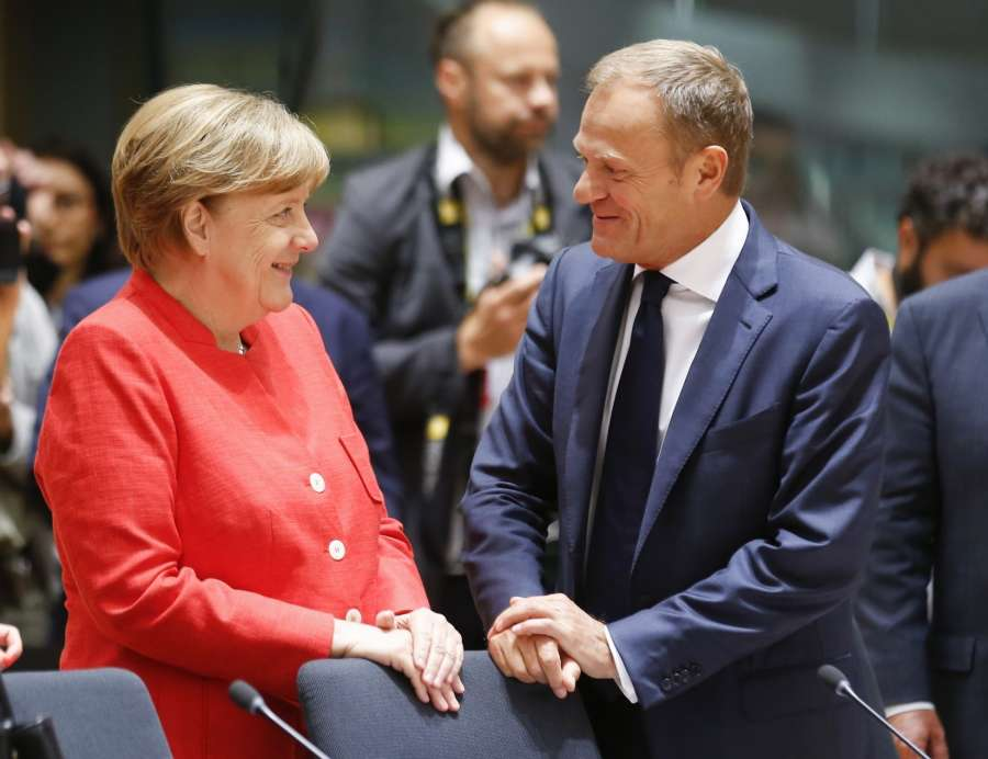 Brussels: German Chancellor Angela Merkel (L) talks with European Council President Donald Tusk at second day's EU Summit in Brussels, Belgium, June 23, 2017. (Xinhua/Ye Pingfan/IANS) by .