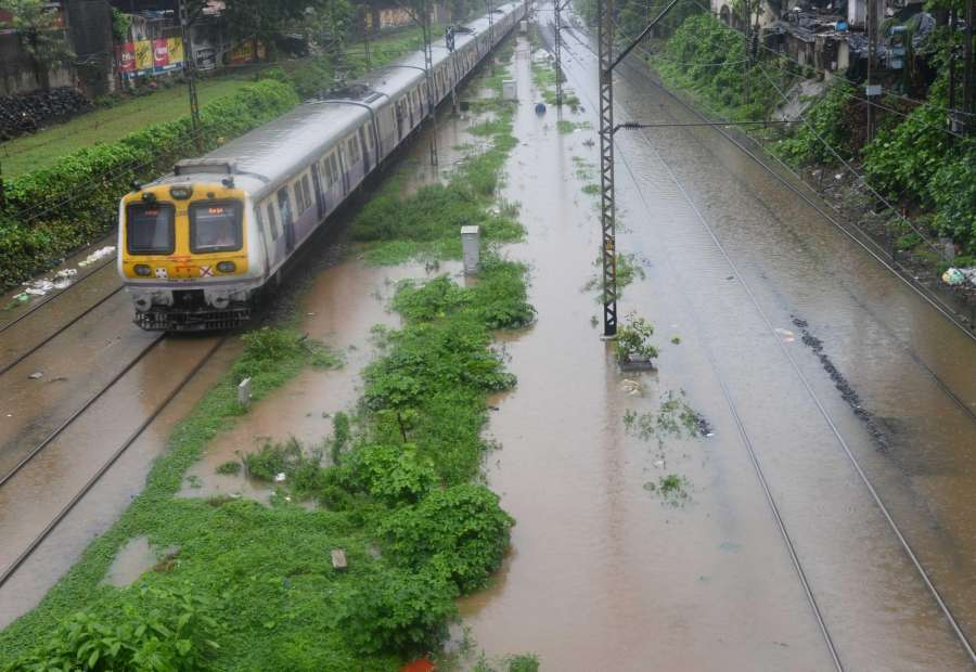 Mumbai: A view of submerged track as heavy rain hit train services in Mumbai on June 27, 2017. (Photo: IANS) by .