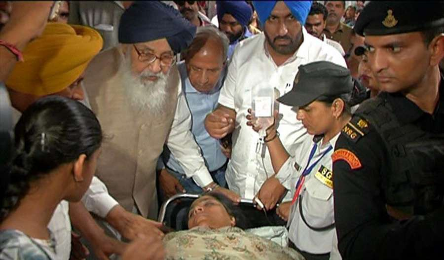 Shiromani Akali Dal leader Parkash Singh Badal visits AAP MLA Sarabjit Kaur Manuke who was admitted to hospital after she sustained injuries while being forcibly evicted from Punjab Assembly in Chandigarh, on June 22, 2017. (Photo: IANS) by .