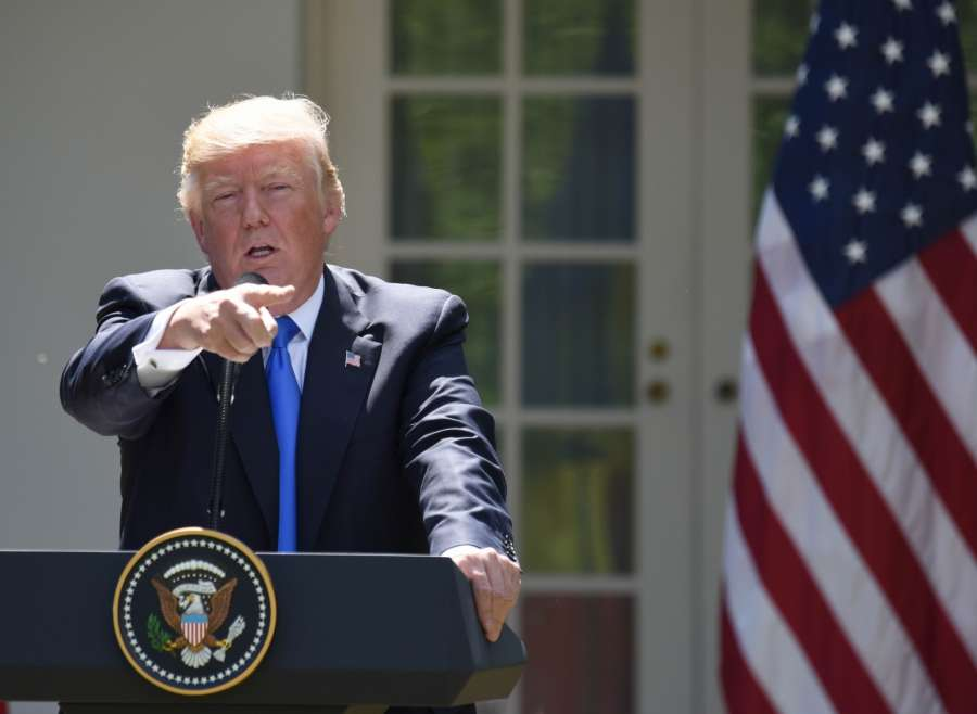 WASHINGTON, June 9, 2017 (Xinhua) -- U.S. President Donald Trump attends a joint press conference with visiting Romanian President Klaus Iohannis (not in the picture) at the White House in Washington D.C., the United States, on June 9, 2017. During the press conference, U.S. President Donald Trump accused Qatar of funding terrorism