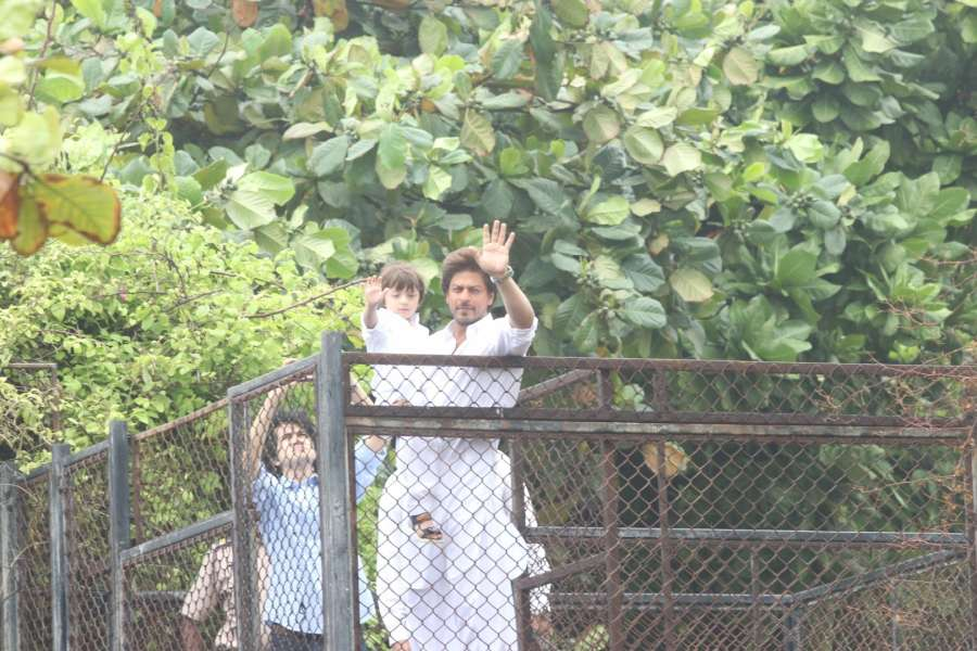 Mumbai: Actor Shah Rukh Khan along with his son AbRam geets his fans on the occasion of Eid-ul-Fitr at his residence in Mumbai on June 26, 2017. (Photo: IANS) by .