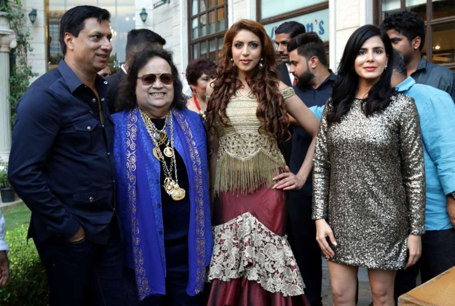 "New Delhi: (L-R) Filmmaker Madhur Bhandarkar, music composer Bappi Lahiri, makeover expert Ishika Taneja and actress Kirti Kulhari at the launch of his upcoming film ""Indu Sarkar's"" song ""Dilli Ki Raat"" in New Delhi, on July 14, 2017. (Photo: Amlan Paliwal/IANS) by ."