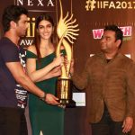 New Delhi: Actors Kriti Sanon and Sushant Singh Rajput with composer AR Rahman during a press conference regarding International Indian Film Academy (IIFA) Awards; in New Delhi on July 4, 2017. (Photo: Amlan Paliwal/IANS) by .