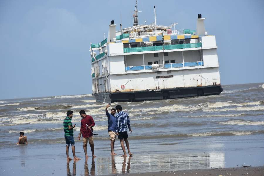 Panaji: Offshore casino vessel 'MV Lucky Seven' that hit a sandbar drifting in choppy waters in the Aguada bay off Panaji on July 16, 2017. An Indian Coast Guard team rescued four ailing crew members of the vessel. (Photo: IANS) by .