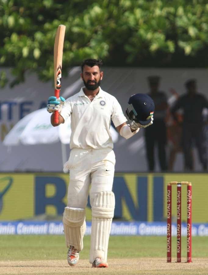 Galle (Sri Lanka): India's Cheteshwar Pujara celebrates his century on Day 1 of the first test match between India and Sri Lanka at Galle International Stadium in Galle, Sri Lanka on July 26, 2017. (Photo: Surjeet Yadav/IANS) by .