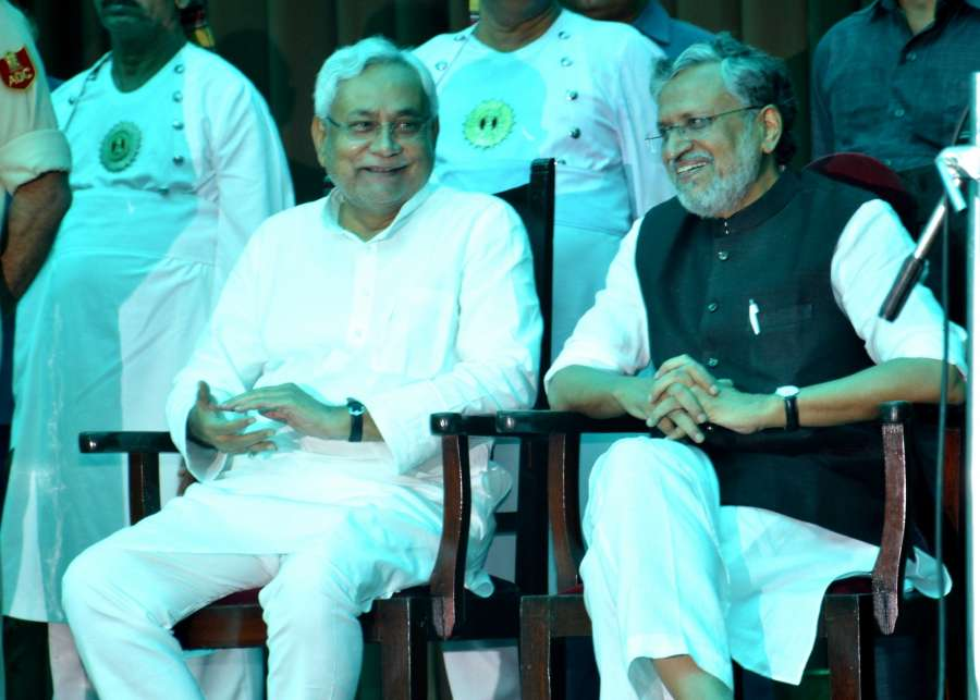 Patna: JD(U) leader Nitish Kumar and BJP leader Sushil Kumar Modi during the swearing in ceremony of Kumar as Chief Minister of Bihar at Raj Bhavan in Patna on July 27, 2017. (Photo: IANS) by .