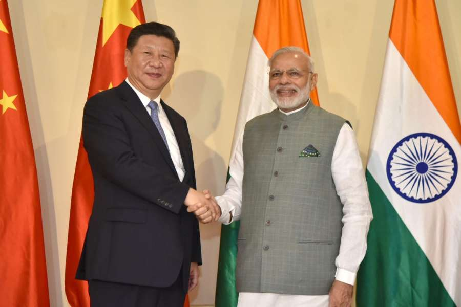 Goa: Prime Minister Narendra Modi meets Chinese President Xi Jinping before the BRICS Summit in Goa on Oct 15, 2016. (Photo: IANS/PIB) by .