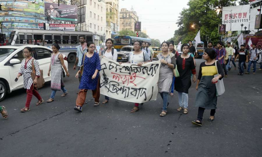Kolkata: SFI and DYFI activists stage a demonstration against lathi charge on tea garden workers in Kolkata, on June 14, 2017. (Photo: IANS) by .
