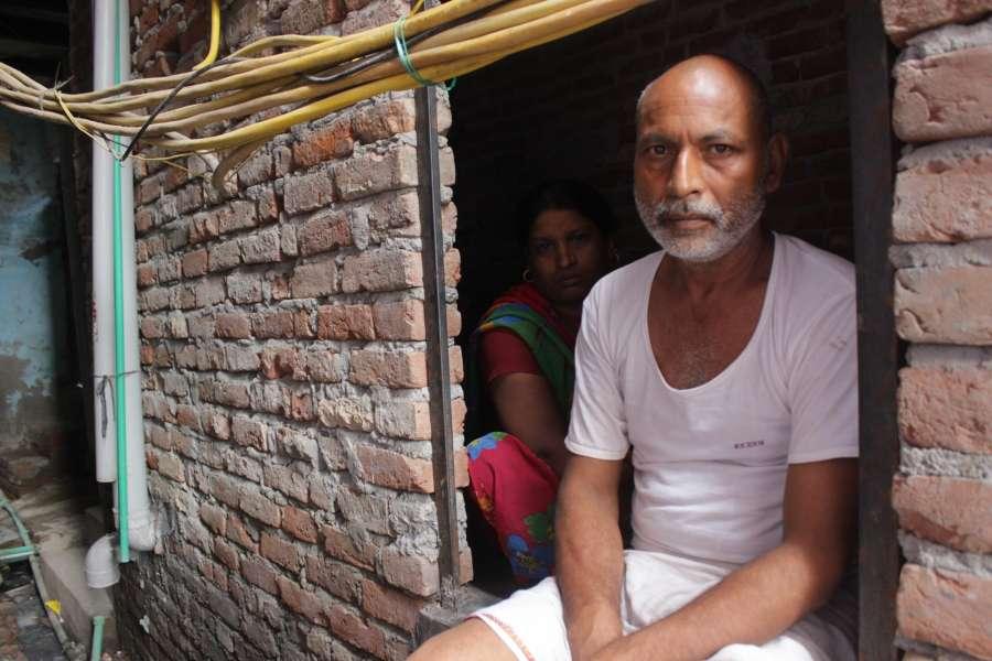 New Delhi: Giri's father Tirubhuvan, 50 at his two-room under-construction house. (Photo: Nikhil Babu/IANS) by .
