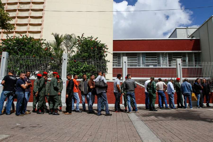 CARACAS, July 31, 2017 (Xinhua) -- Residents and members of the military wait to vote for the elections of the National Constituent Assembly (ANC) at a polling station in Caracas, Venezuela, on July 30, 2017. Venezuela's Vice President Tareck El Aissami said on Sunday that voting was proceeding smoothly, except for an