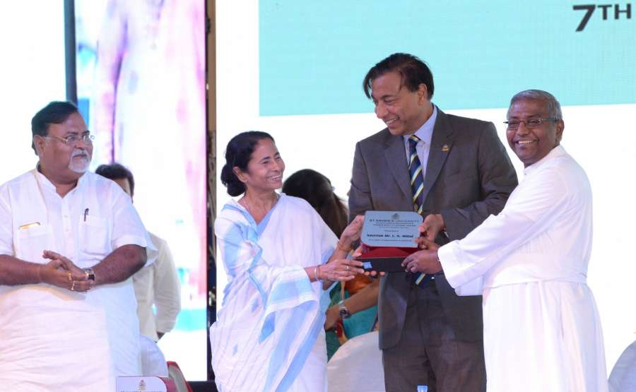 Kolkata: West Bengal Chief Minister Mamata Banerjee and Education Minister Partha Chatterjee with ArcelorMittal Chairman and CEO Lakshmi N Mittal during a programme organised to start the first academic session of St. Xavier's College's Rajarhat campus in Kolkata on July 7, 2017. (Photo: IANS) by .