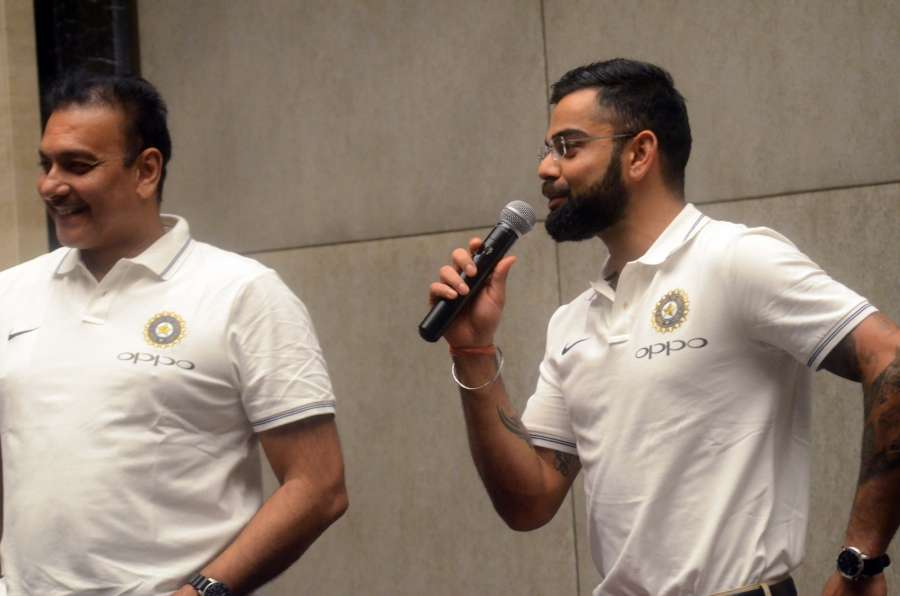 Mumbai: Indian captain Virat Kohli and head coach Ravi Shastri during a press conference before the team's departure for the tour of Sri Lanka - featuring three Tests, five ODIs and a Twenty20 starting July 26; in Mumbai on July 19, 2017. (Photo: IANS) by .