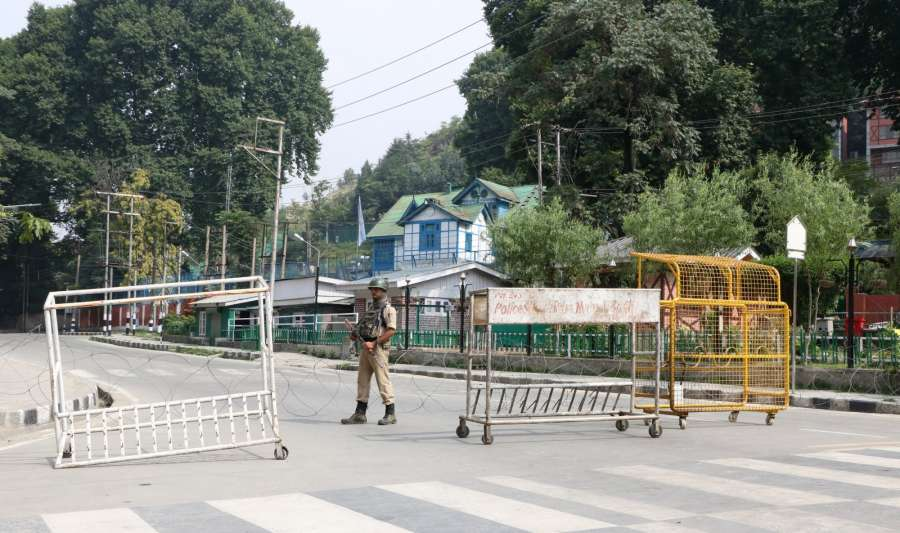 Srinagar: A soldier mans a Srinagar road as authorities imposed restrictions in parts of summer capital to prevent a separatist called protest shutdown and sit-in demonstration on July 21, 2017. (Photo: IANS) by .