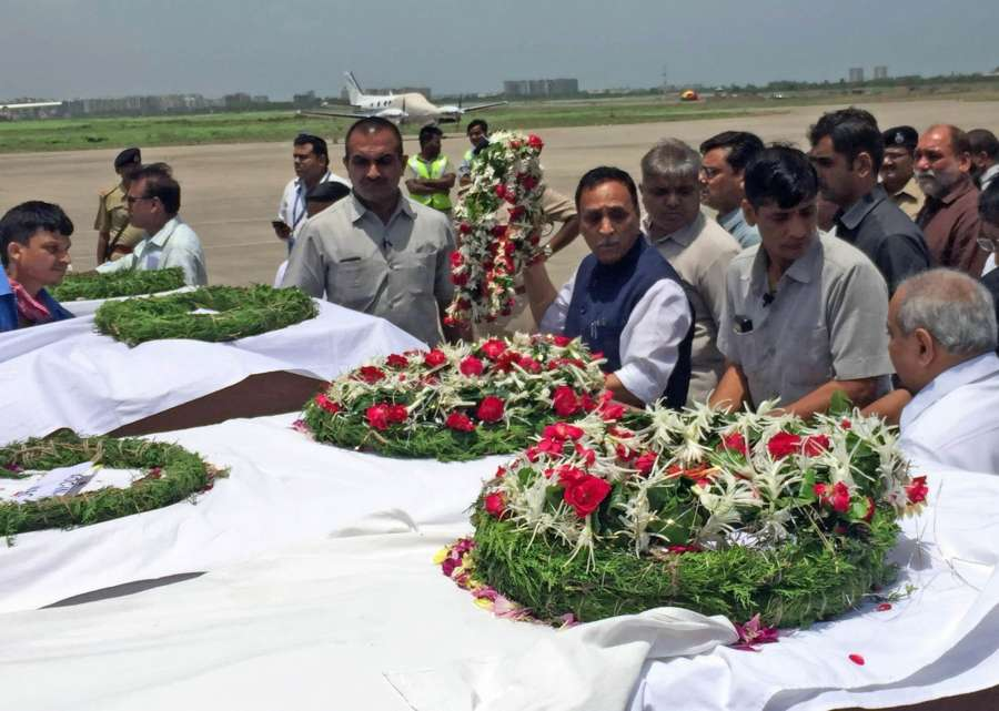 Surat: Gujarat Chief Minister Vijay Rupani pays tribute to Amarnath pilgrims killed in a militant attack, in Surat on July 10, 2017. (Photo: IANS) by .