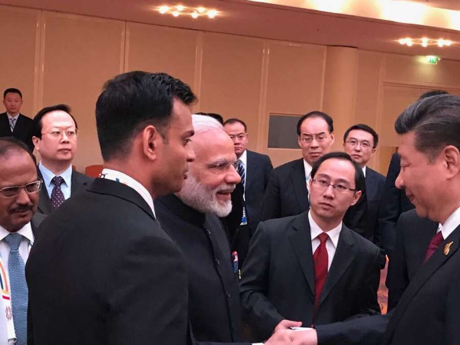 Hamburg (Germany): Prime Minister Narendra Modi and Chinese President Xi Jinping greet each other on the sidelines of the 12th G-20 Summit, at Hamburg, Germany on July 7, 2017. (Photo: IANS/MEA) by .
