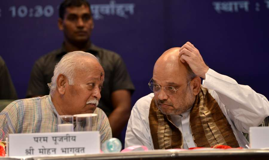"""New Delhi: RSS Chief Mohan Bhagwat and BJP chief Amit Shah at the lunch of """"The making of a Legend"""" - a book on Prime Minister Narendra Modi written by and Sulabh International founder Bindeshwar Pathak in New Delhi on July 12, 2017. (Photo: IANS) by ."""