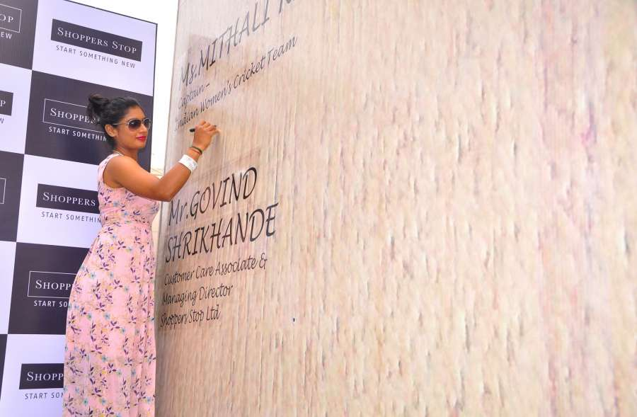 Bengaluru: Indian women's cricket team captain Mithali Raj gives an autograph on a huge cricket bat claimed to be world's largest by a retailing company that has created in Bengaluru on April 20, 2017. (Photo: IANS) by .