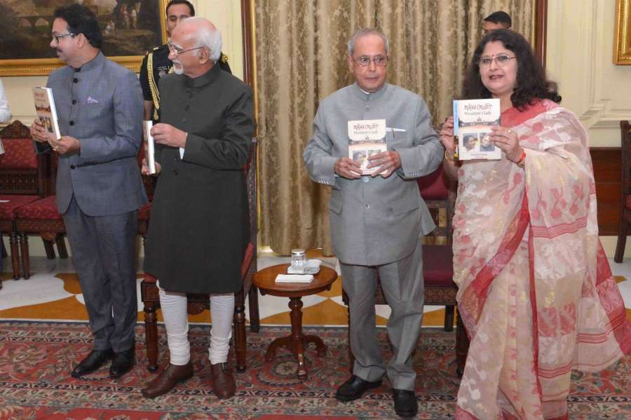 New Delhi: President Pranab Mukherjee receives the first copy of the Book 'President's Lady (Pranaber Preyosi)' authored by Sangeeta Ghosh at Rashtrapati Bhavan in New Delhi on July, 13, 2017. Also seen Vice President M Hamid Ansari. (Photo: IANS/RB) by .