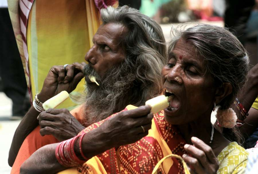 New Delhi: Farmers demonstrating against killing of farmers in alleged police firing in Madhya Pradesh's Mandsaur beat the heat with ice cream in New Delhi on June 15, 2017. (Photo: IANS) by .