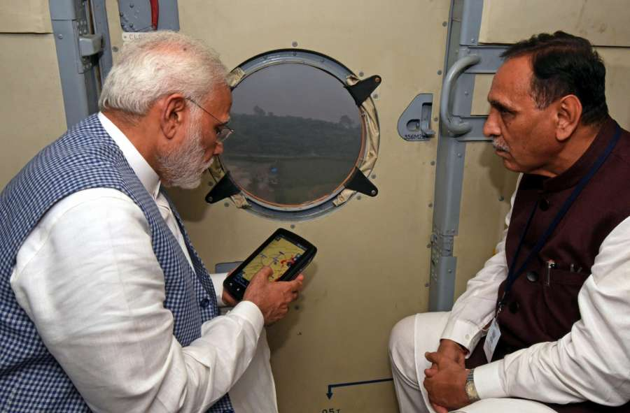 Gujarat: Prime Minister Narendra Modi conducts aerial survey of flood affected areas of Gujarat on July 25, 2017. Also seen Gujarat Chief Minister Vijay Rupani. (Photo: IANS) by .
