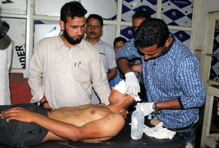 Shopian: One of the youths who sustained pellet injuries during clashes with security personnel in Awneera village of South Kashmir's Shopian district on Aug 13, 2017. Two soldiers and three militants were killed in a gunfight. Acting on specific information, the security forces surrounded the village on Saturday evening upon which they were fired at by the militants that resulted in the gunfight. (Photo: IANS) by .