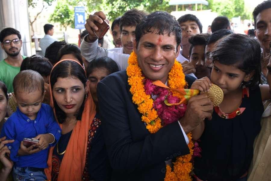 Jaipur: Rio gold medallist Paralympian Devendra Jhajharia (Javelin Throw) arrives at Jaipur International Airport in Jaipur on Sept 24, 2016. (Photo: Ravi Shankar Vyas/IANS) by .