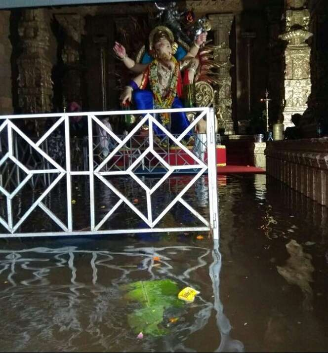 Mumbai: A view of a flooded Ganesh pandal after rains lashed Mumbai on Aug 29, 2017. (Photo: IANS) by .