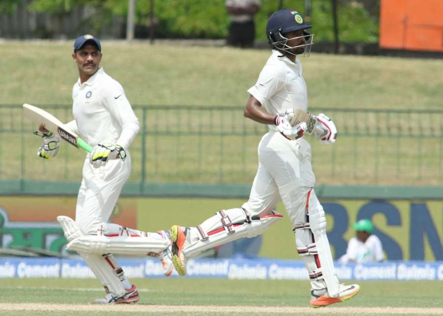 Colombo: India's Wriddhiman Saha and Ravindra Jadeja on Day 2 of the second test match between India and Sri Lanka at Sinhalese Sports Club Ground in Colombo, Sri Lanka on Aug 4, 2017. (Photo: Surjeet Yadav/IANS) by .