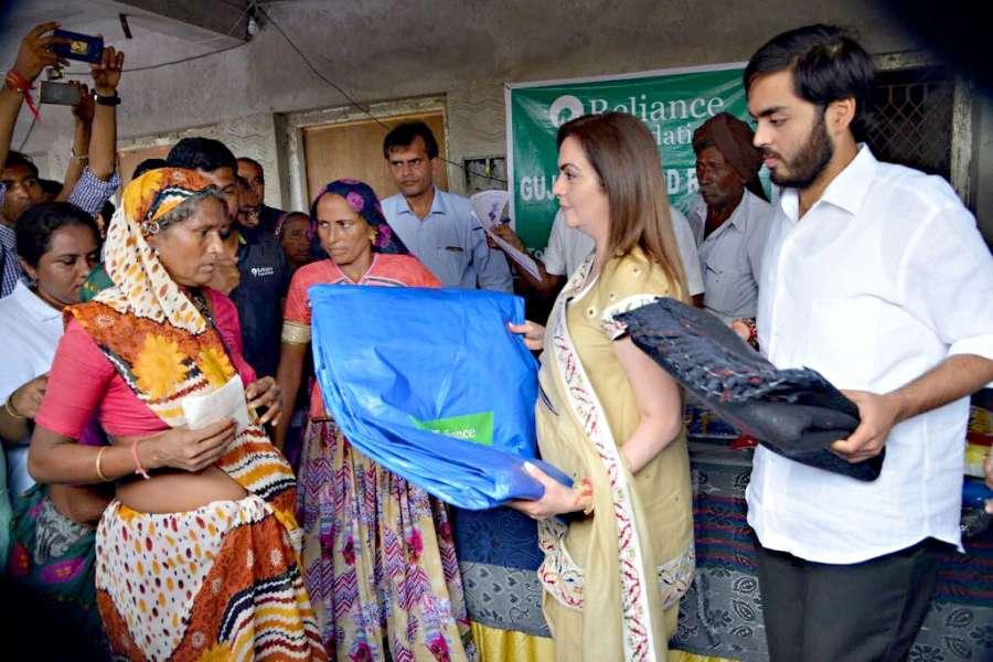 Banaskantha: Reliance Foundation (RF) Chairperson Nita Ambani meets flood victims of Banaskantha district of Gujarat on Aug 9, 2017. (Photo: IANS) by .