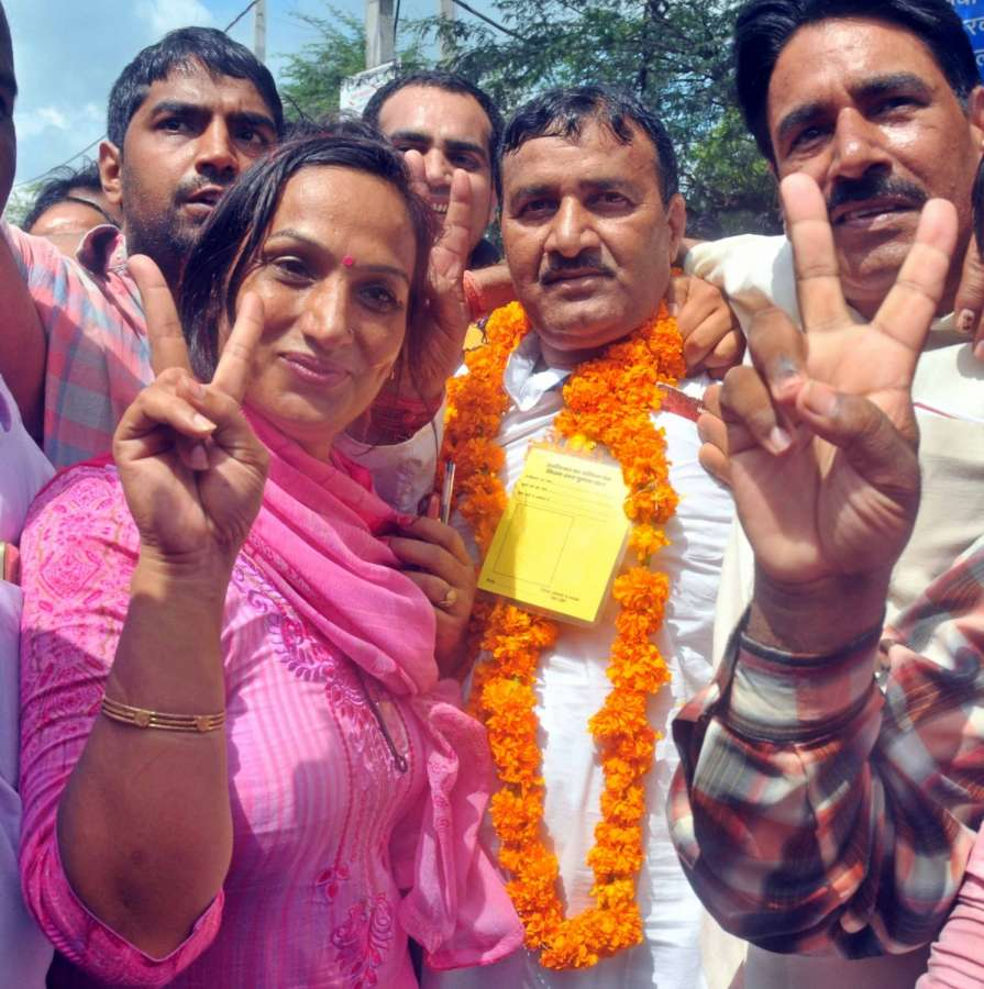 New Delhi: AAP candidate Ram Chander celebrates after winning the Bawana assembly bypoll in New Delhi on Aug 28, 2017. (Photo: IANS) by .