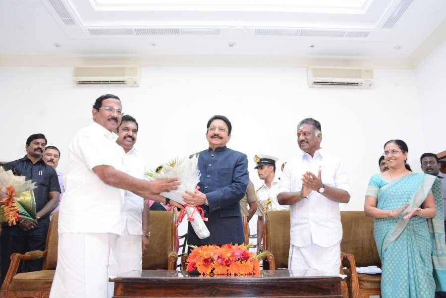 Chennai: Tamil Nadu Chief Minister Edappadi K. Palaniswami,Tamil Nadu governor C. Vidyasagar Rao at the swearing in ceremony of O. Panneerselvam as the Deputy Chief Minister of the state in Chennai on Aug 21, 2017. (Photo: IANS) by .