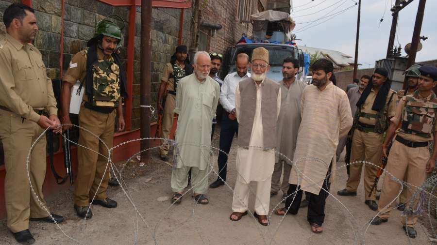 Srinagar: Hardline Hurriyat Conference chairman Syed Ali Shah Geelani being taken away by police after he tried to proceed towards martyrs' graveyard in Khawaja Bazar area of Srinagar, on July 13, 2017. (Photo: IANS) by .