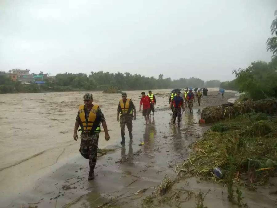 BIRATNAGAR, Aug. 12, 2017 (Xinhua) -- Rescuers evacuate resients suffered from flood in Biratnagar, Nepal, on Aug. 12, 2017. Monsoon-induced floods have created havoc across the low-lying areas known as Terai region in Nepal since Friday night. (Xinhua/IANS) by .