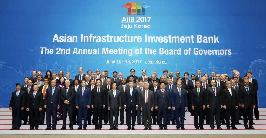 Participants pose during the opening ceremony of the second annual meeting of the Asian Infrastructure Investment Bank (AIIB) at a convention center on South Korea's Jeju Island on June 16, 2017. The three-day meeting is attended by representatives of the 77 AIIB member countries, and some 2,000 businessman and journalists from around the world. (Yonhap/IANS) by .