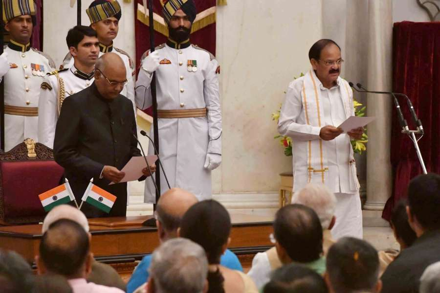 New Delhi: President Ram Nath Kovind administering the oath of office to Venkaiah Naidu as Vice-President during the swearing-in-ceremony at Rashtrapati Bhavan on Aug. 11, 2017. (Photo: IANS/RB) by .