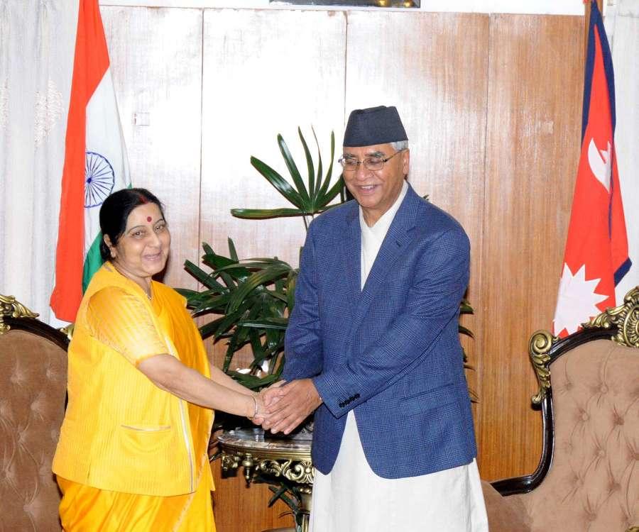 Kathmandu: External Affairs Minister Sushma Swaraj calls on Nepal Prime Minister Sher Bahadur Deuba in Kathmandu on Aug 10, 2017. (Photo: IANS/MEA) by .