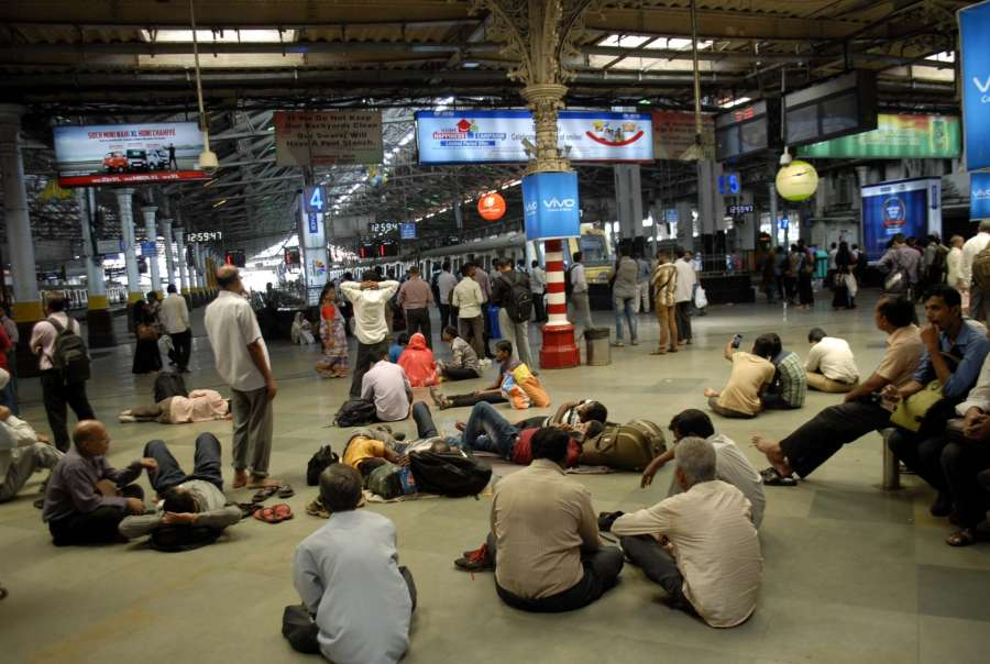 Mumbai: Stranded passengers wait for their respective trains at the Chhatrapati Shivaji Terminus (CST) railway station after rains lashed Mumbai on Aug 30, 2017. (Photo: Sandeep Mahankal/IANS) by .