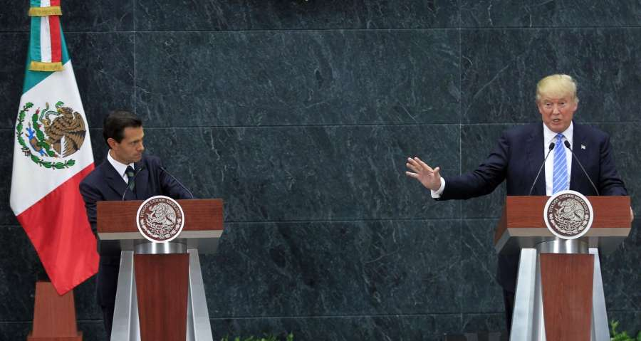 MEXICO CITY, Aug. 31, 2016 (Xinhua) -- U.S. Republican presidential candidate Donald Trump (R) addresses a joint press conference with Mexican President Enrique Pena Nieto (L) after their meeting in Mexico City, capital of Mexico, on Aug. 31, 2016. (Xinhu by .