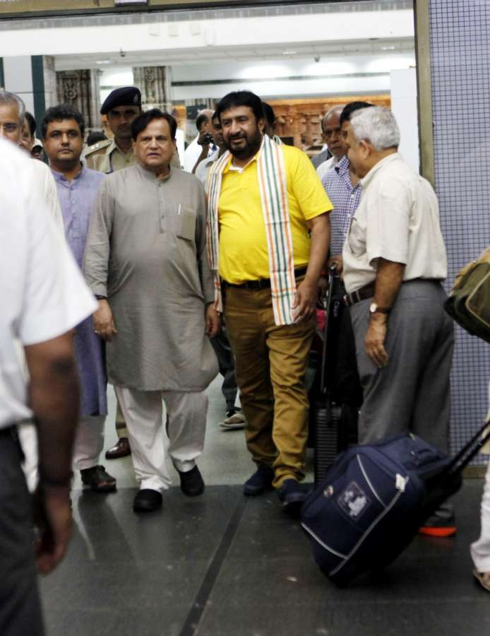 Ahmedabad: Ahmed Patel, political aide to the Congress president Sonia Gandhi arrives in Ahmedabad along with party MLAs from Gujarat, who were camping at a resort on the outskirts of Bengaluru in party-ruled Karnataka for the past nine days; at Sardar Vallabhbhai Patel International Airport on Aug 7, 2017. Gujarat Congress MLAs were in Bengaluru since July 29 to prevent their possible poaching by the ruling BJP for the Rajya Sabha election where the Congress is attempting to get Ahmed Patel, the political aide to party president Sonia Gandhi, re-elected. (Photo: IANS) by .