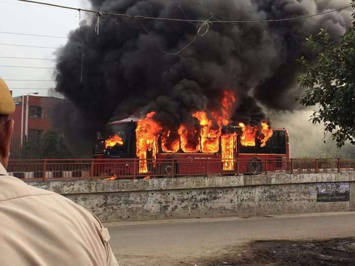 Loni: A Delhi transport corporation (DTC) bus set on fire by protesters at Loni of Ghaziabad after the conviction of Dera Sacha Sauda sect chief Gurmeet Ram Rahim Singh in a rape case on Aug 25, 2017. At least five people have died in the violence by Dera Sacha Sauda followers. (Photo: IANS) by .