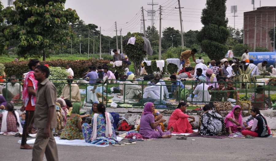 Panchkula: Followers of Dera Sacha Sauda chief Gurmeet Ram Rahim Singh gather ahead of the Aug 25 verdict of the CBI court in the rape case against Dera Sacha Sauda chief Gurmeet Ram Rahim Singh in the Panchkula district of Haryana on Aug 24, 2017. (Photo: IANS) by .