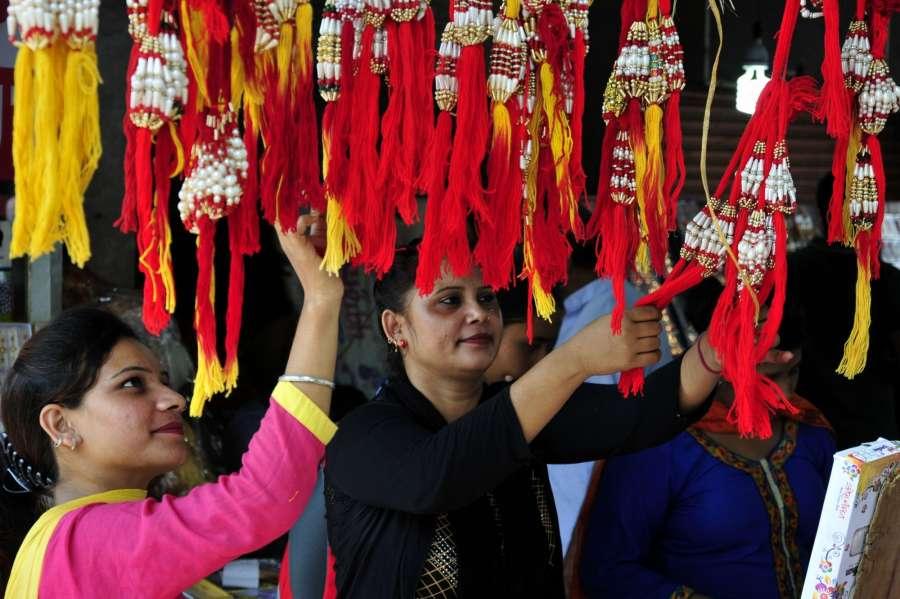 Amritsar: Women busy with Rakhi shopping ahead of Raksha Bandhan in Amritsar on Aug 5, 2017. (Photo: IANS) by .