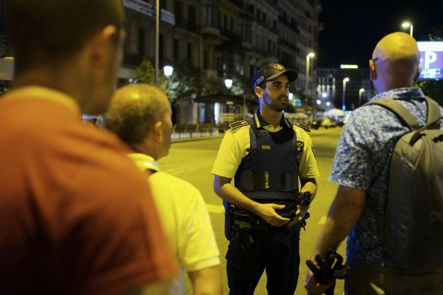 BARCELONA, Aug. 18, 2017 (Xinhua) -- A security staff talks to pedestrians following a terrorist attack in central Barcelona, Spain, on Aug. 17, 2017. Thirteen people were confirmed dead and more than 100 others injured, with some of them in very serious condition in Barcelona terror attack on Thursday afternoon, a Spanish official said. (Xinhua/Han Chong/IANS) by .