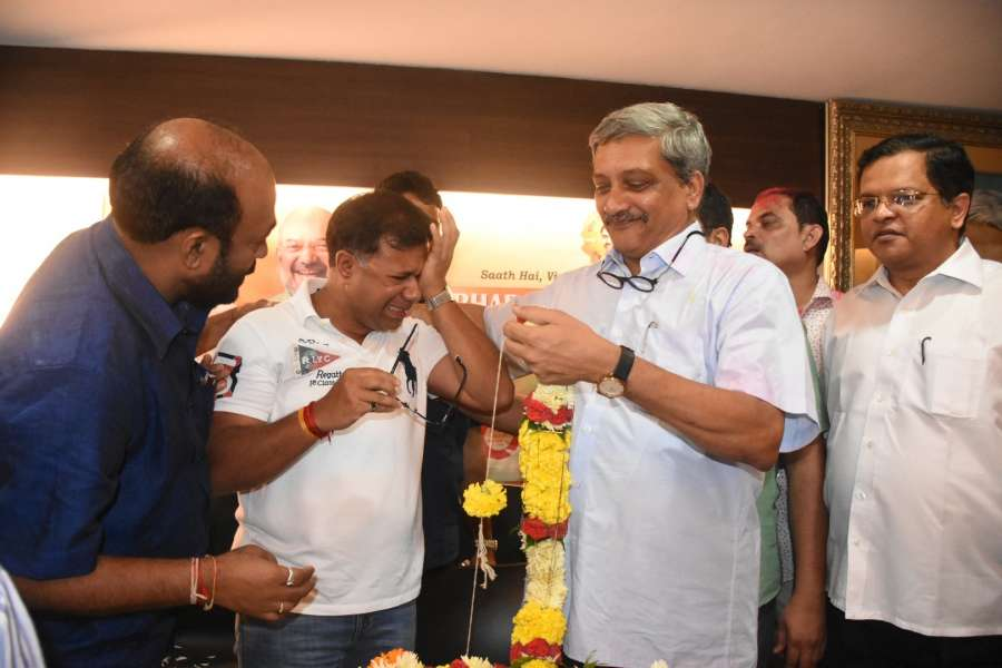 Panaji: Goa Chief Minister Manohar Parrikar and Health Minister Vishwajit Rane celebrating after wining the Panaji and Valpoi bypolls in Panaji on Aug. 28, 2017. (Photo: IANS) by .