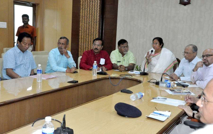 Howrah: West Bengal Chief Minister Mamata Banerjee and Gorkha Janamukti Morcha (GJM) joint secretary Binay Tamang along with other representatives during a meeting on Darjeeling issue at Nabanna in Howrah on Aug 29, 2017. (Photo: IANS) by .