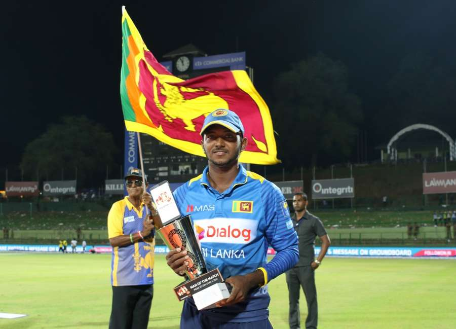 Pallekele: Sri Lanka's Akila Dananjaya with the Man of the Match trophy during the second one-day international cricket match between India and Sri Lanka in Pallekele, Sri Lanka on Aug. 24, 2017. (Photo: Surjeet Yadav/IANS) by .