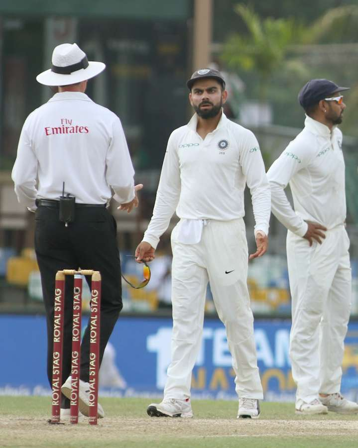 Colombo: Indian skipper Virat Kohli interacts with umpire after appalling for review of Sri Lanka's batsman Kusal Mendis on Day 2 of the second test match between India and Sri Lanka at Sinhalese Sports Club Ground in Colombo, Sri Lanka on Aug 4, 2017. (Photo: Surjeet Yadav/IANS) by .
