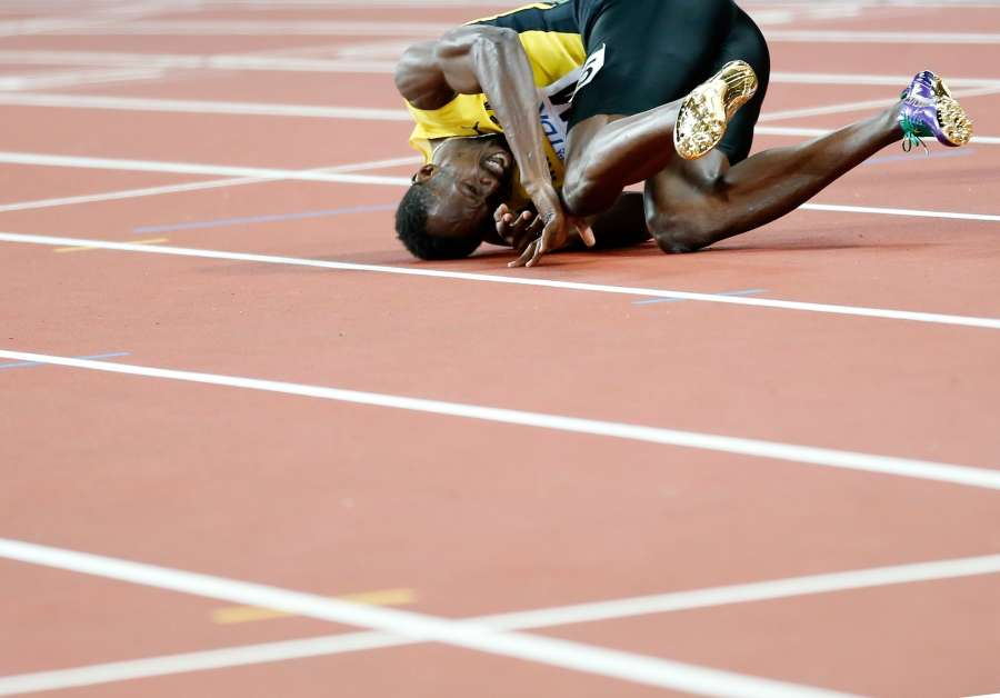 LONDON, Aug. 13, 2017 (Xinhua) -- Usain Bolt of Jamaica falls down as he walks to the finish line during Men's 4x100m Relay Final on Day 9 of the 2017 IAAF World Championships at London Stadium in London, Britain, on Aug. 12, 2017. (Xinhua/Wang Lili/IANS) by .