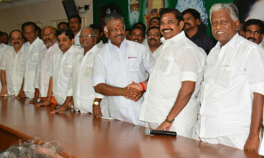 Chennai: Tamil Nadu Chief Minister Edappadi K. Palaniswami along with the state's former chief minister O. Paneerselvam during the merger of the two factions of AIADMK at the party's headquarters in Chennai on Aug 21, 2017. (Photo: IANS) by .